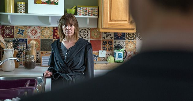 How will Rhona Goskirk react when she finds Pierce Harris in her living room in Emmerdale.