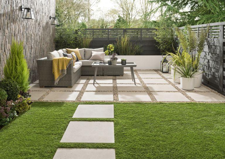 paved patio area with a corner sofa