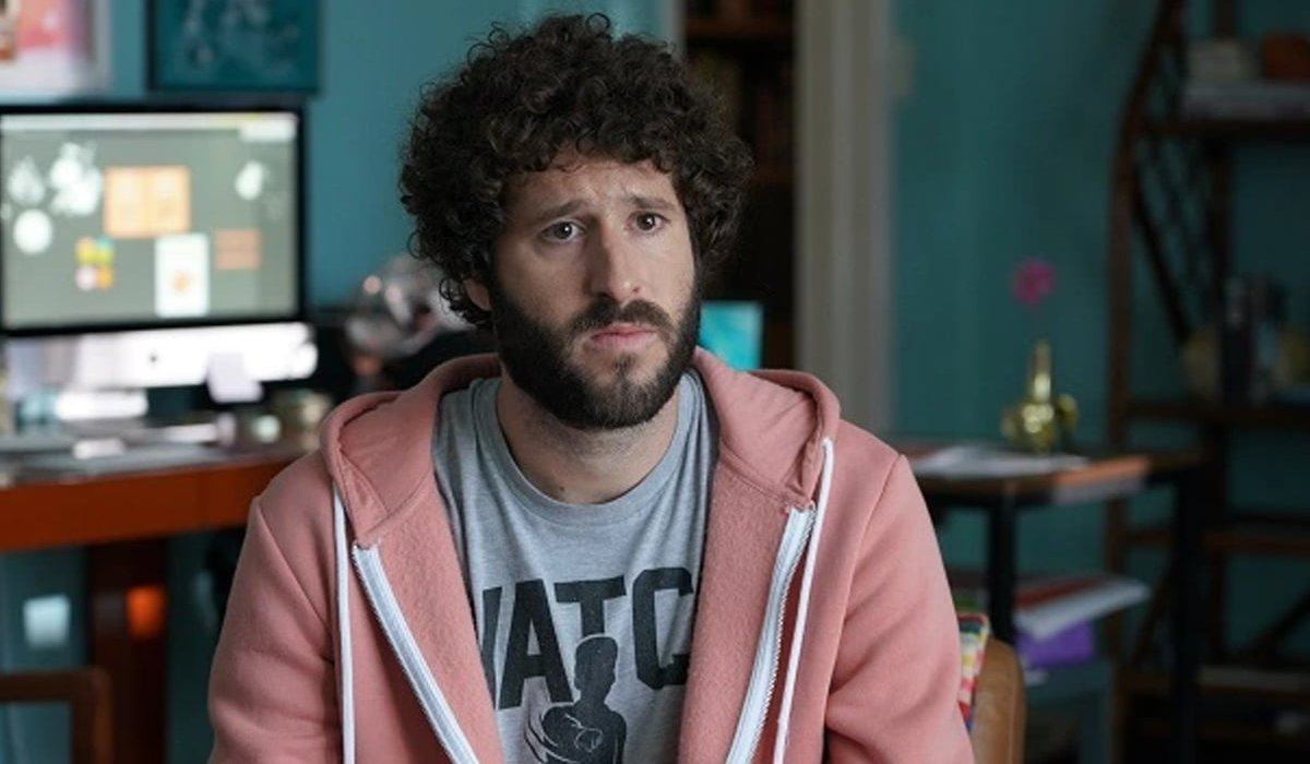 Lil Dicky sitting with a worried expression in Dave.