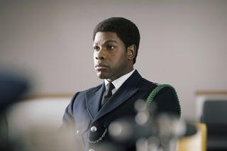 "John Boyega plays Metropolitan Police officer Leroy Logan in ""Small Axe."""