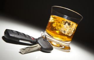 A set of car keys and a drink