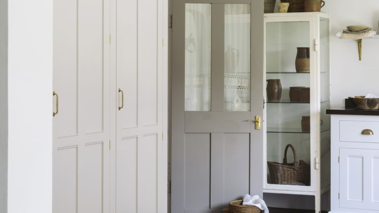 Bootility room with gray painted door in country style kitchen