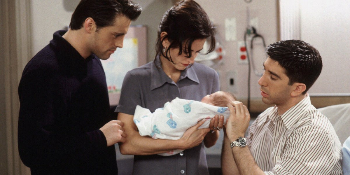 Monica holding Ben next to Joey and Ross in Friends.