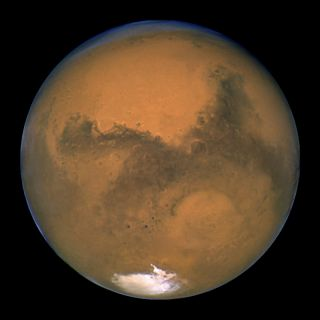 """Mars and its """"rival,"""" the red star Antares, will dance together in the night sky on Sept. 28, 2014."""