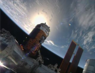The HTV-4 (Kounotori 4) cargo ship built by Japan's space agency is in docking position at International Space Station in this still from a NASA TV broadcast on Aug. 9, 2013.