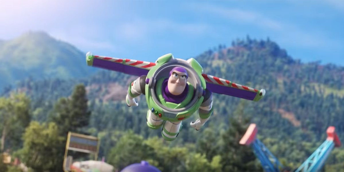 Buzz Lightyear flying high above a carnival.