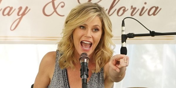 modern family's claire on the mic for jay and gloria's anniversary