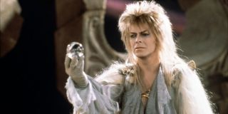 Labyrinth David Bowie ominously holds a crystal ball in his hand