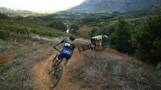 Nino Schurter leads through a corner during the 2019 Cape Epic which he won with teammate Lars Forster