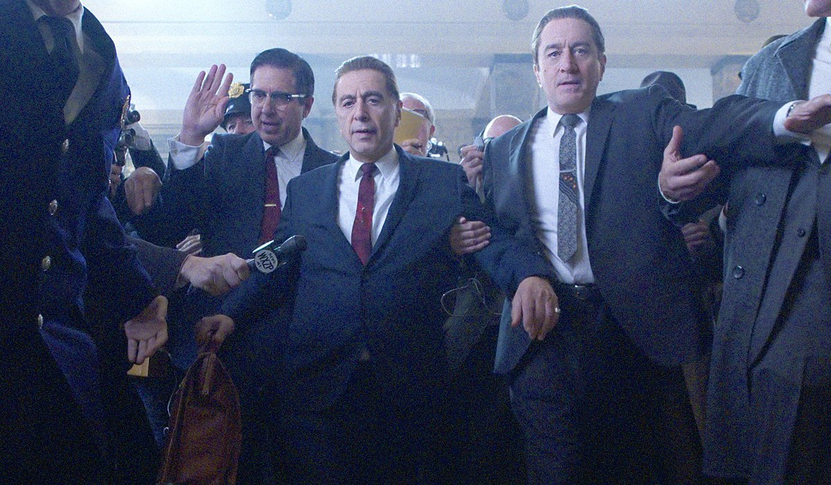 The Irishman Ray Romano Al Pacino and Robert DeNiro being escorted out of a crowded courtroom