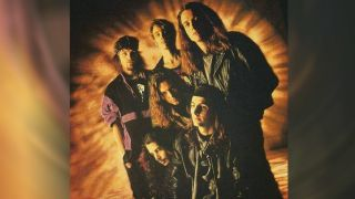 Temple Of The Dog standing in front of a sunburst background.