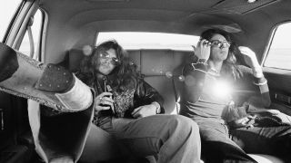 Bass player Glenn Hughes (left) and singer David Coverdale (right) from Deep Purple posed in the back of a limousine car during the band's American tour in November 1974.