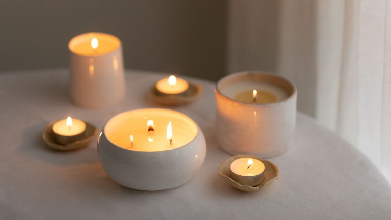 selection of different sized lit scented candles