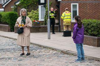 Evelyn Plummer clocks Hope's face when the fire safety officer arrives.