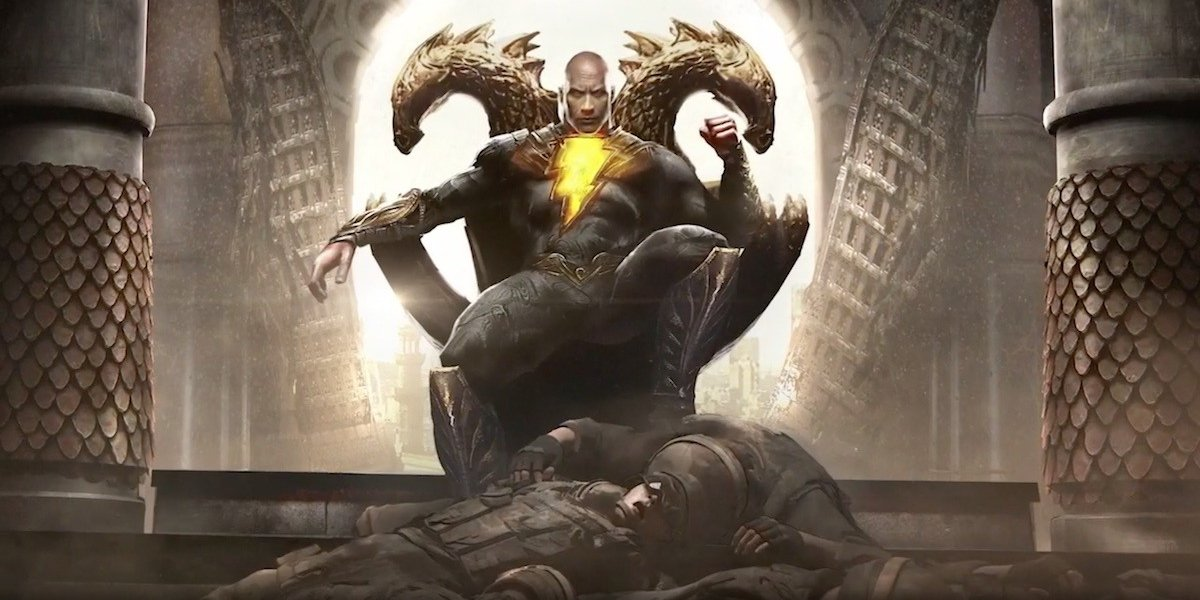 Dwayne Johnson sits on a throne in front of a pile of bodies in Black Adam.