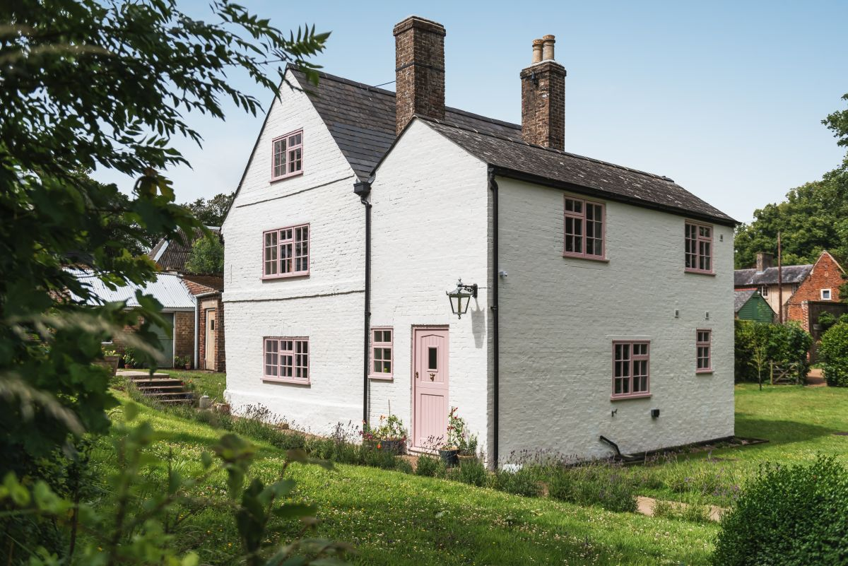 Inside an historic English picture-perfect cottage, bursting with life, color and pattern