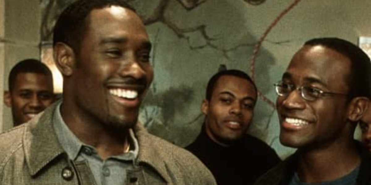 Morris Chestnut and Taye Diggs smiling at a party in The Best Man
