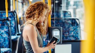 Woman using contactless card payment for public transport