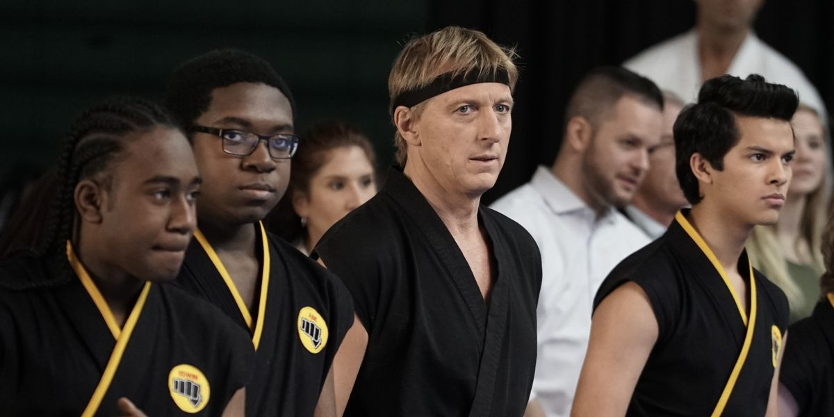 Johnny with some of his students at a competition in Cobra Kai.