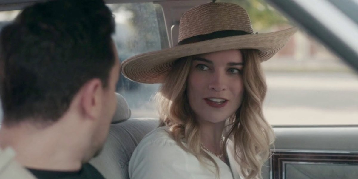 David and Alexis in the car in Schitt's Creek.