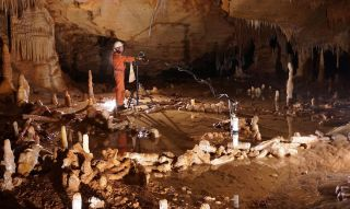 Scientists take measurements for the archaeo-magnetic survey in the Bruniquel Cave, where they found near-circular structures made of stalagmites.