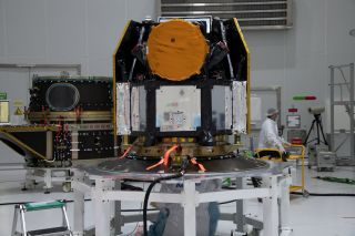 The European Space Agency's exoplanet-hunting Characterising Exoplanets Satellite (CHEOPS) is prepared for launch on an Arianespace Soyuz rocket.