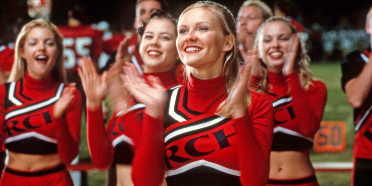 Bring It On Kirsten Dunst claps with her fellow cheerleaders