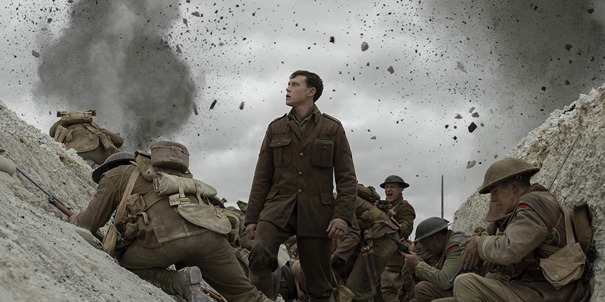 William Schofield (George MacKay) standing and watching an explosion in 1917