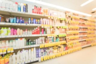 Sunscreen and other skin care products at a pharmacy store.