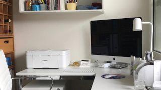 Printer and computer on desk