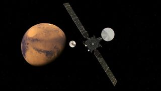 An artist's concept shows the ExoMars orbiter and lander approaching the Red Planet.