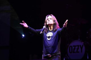 Ozzy Osbourne with arms outstretched