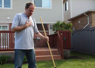 A man doing yardwork develops chest pains.