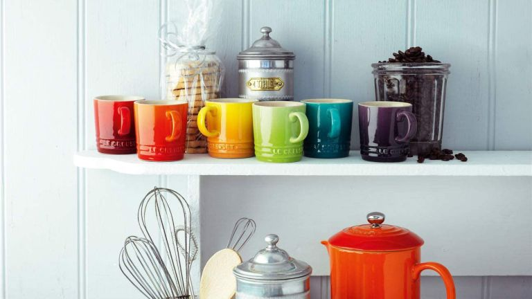 Le Creuset sale: mugs and more on shelf in kitchen