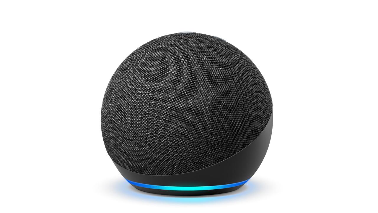 the amazon echo dot smart speaker with its alexa light ring lit up