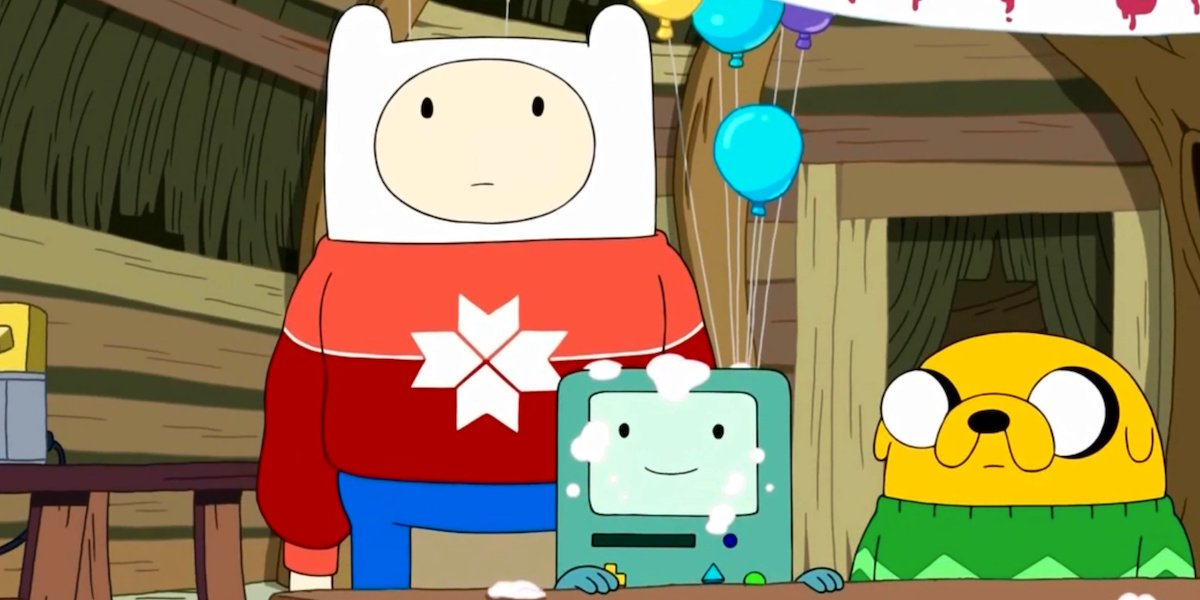 Jake, Finn and their little game cube in Adventure Time.