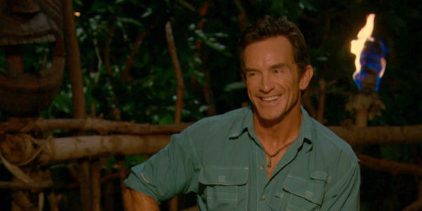 Jeff Probst laughing at tribal council
