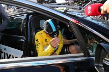 Tony Martin gets in the Etixx Quickstep car but vows to be back