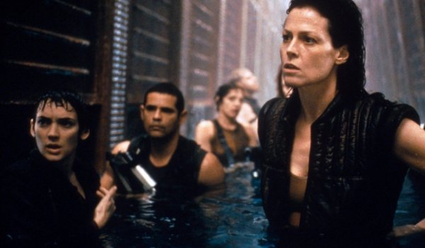 Alien Resurrection Ripley and the crew walking through a flooded hallway