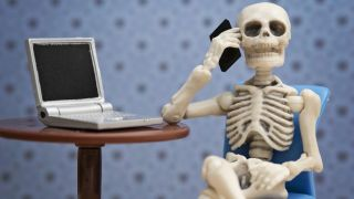skeleton using a laptop