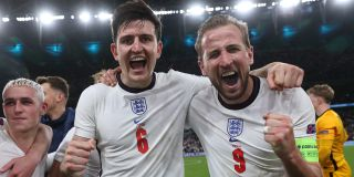 Harrys Macguire (6) and Kane (9) celebrate after England beat Denmark in the Euro 2020 semifinals.