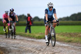 Trixi Worrack of Trek-Segafredo competes through cobblestones sector during the Paris-Roubaix 2021