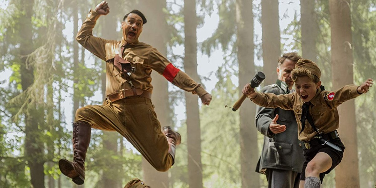 Jojo Rabbit Imaginary Hitler jumps with Jojo in the woods