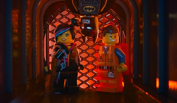 The Lego Movie Wyldstyle and Emmet with Batman dropping in between them