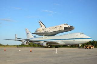 Space shuttle Discovery, mounted atop NASA's modified Boeing 747 Shuttle Carrier Aircraft, is ready for its final ferry flight on Tuesday, April 17, 2012.