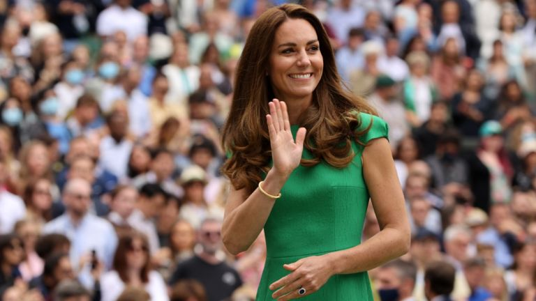 HRH Catherine, The Duchess of Cambridge waves to the crowd after the Ladies' Singles Final match between Ashleigh Barty of Australia and Karolina Pliskova of The Czech Republic on Day Twelve of The Championships - Wimbledon 2021 at All England Lawn Tennis and Croquet Club on July 10, 2021 in London, England.
