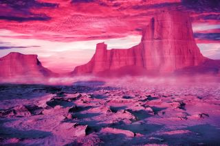 Desert landscape in ultraviolet and pink tones.