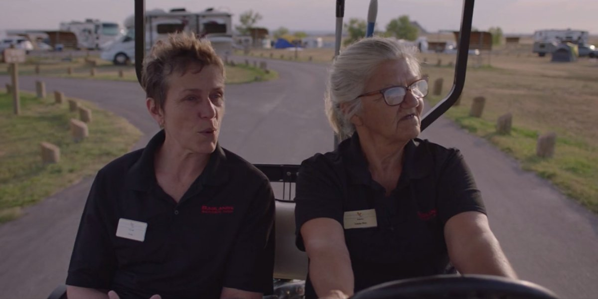 Frances McDormand and Linda May riding in a golf cart in Nomadland
