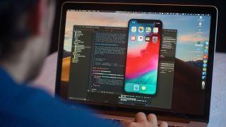 man using xcode for ios app development