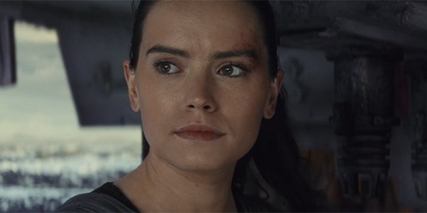 Rey looking back as Luke becomes one with the Force